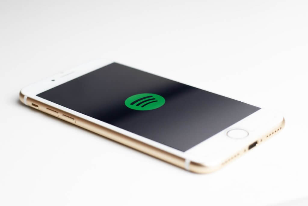 Gold iPhone with Spotify logo - get your music promoted at spotonfire.com